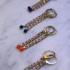 Boucles d'oreilles AVRIL chaine gourmette en laiton et sa perle en verre colorée